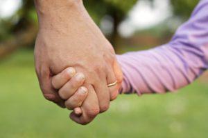 dad holding little hand Medium