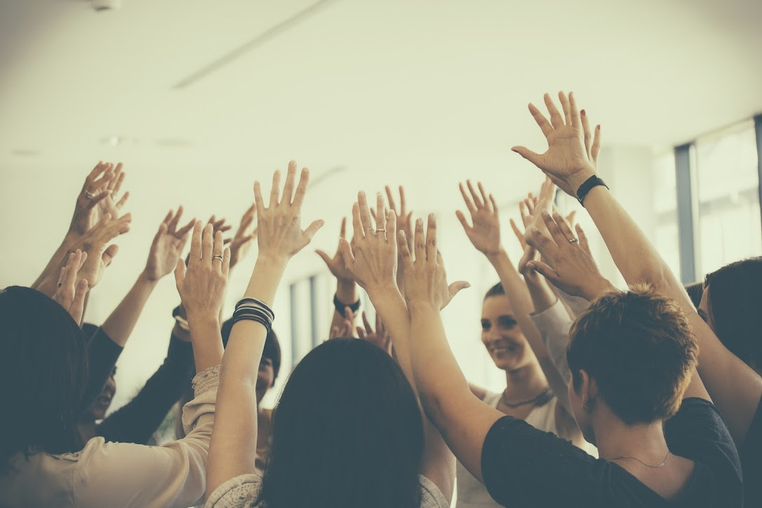 teamwork hands in air
